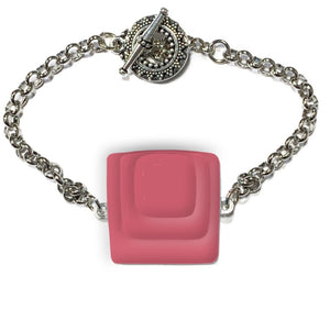 Womans bracelet with square pink center