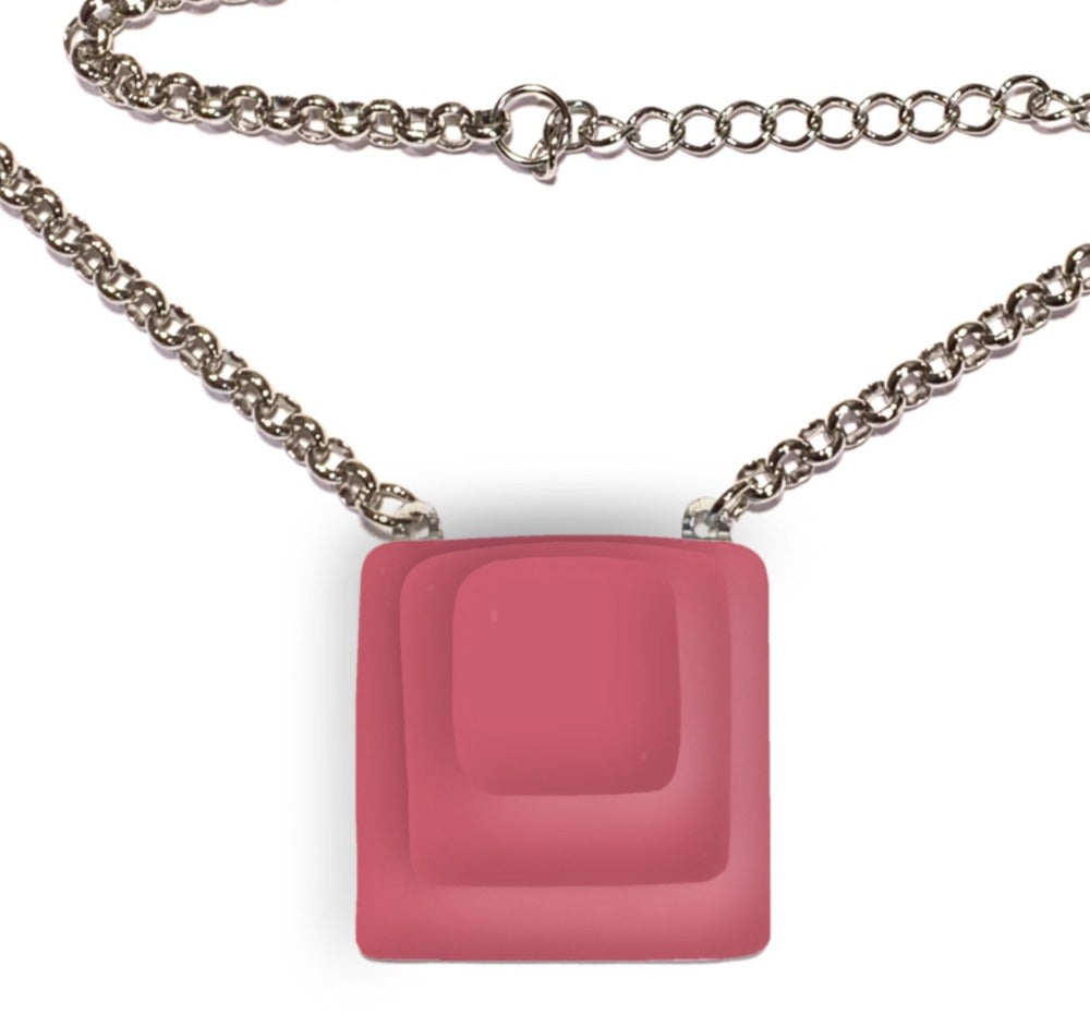 Womans necklace with square pink pendant and silver chain