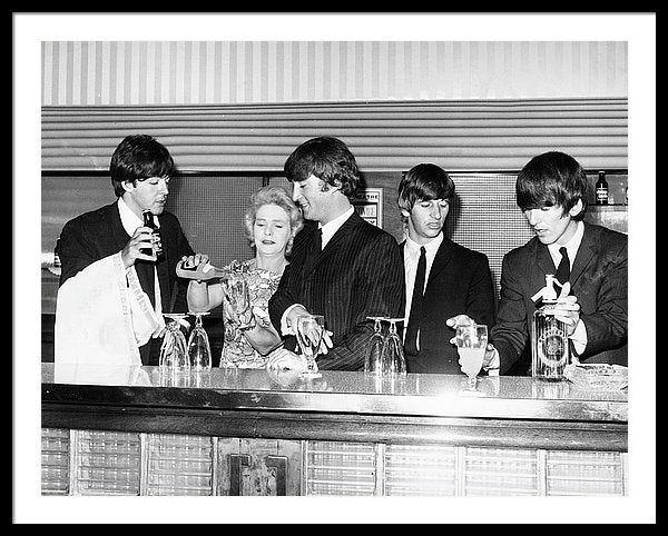 The Beatles behind the bar at London's Prince of Wales theater