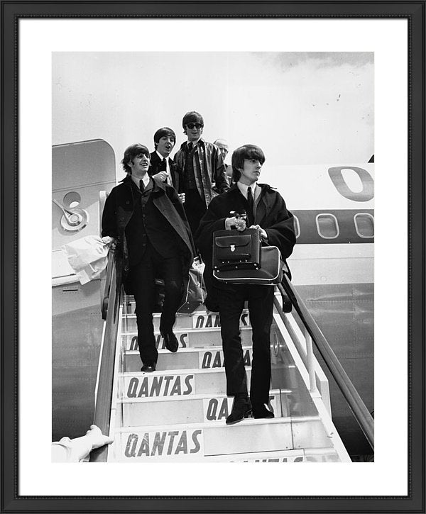 British pop group The Beatles descend the aircraft steps at London Airport