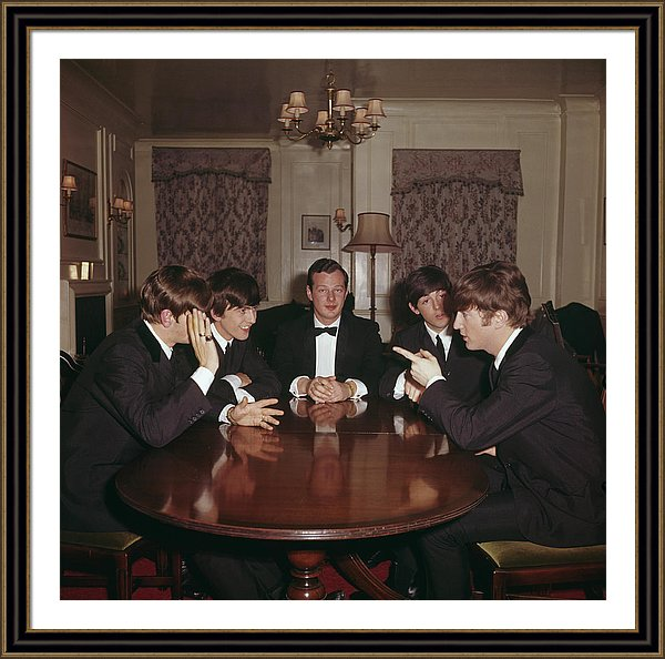 The Beatles with their manager Brian Epstein