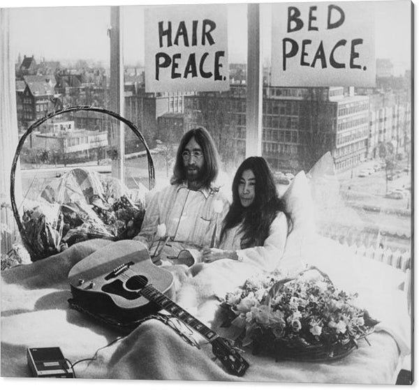 John Lennon & Yoko Ono in their bed in the Presidential Suite of the Hilton Hotel