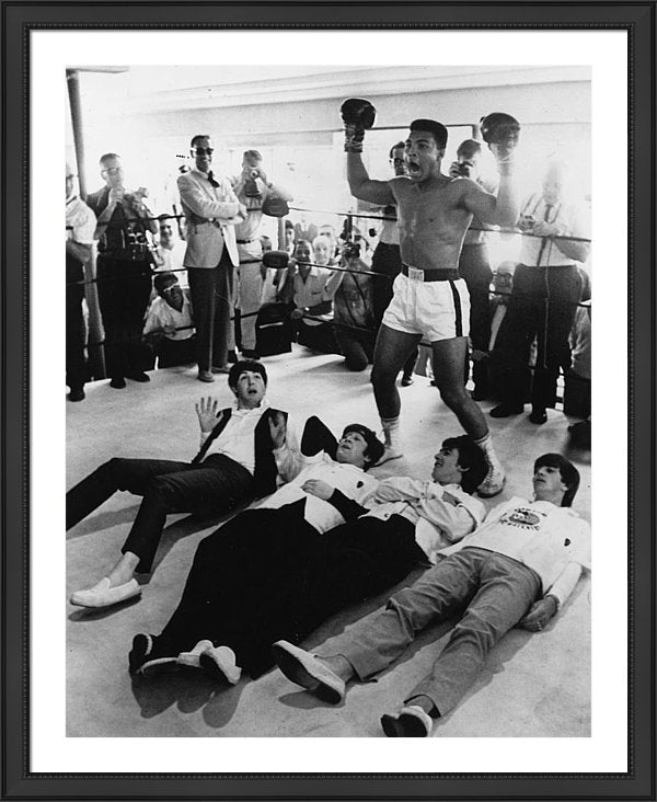 The Beatles, & Cassius Clay poses in mock victory
