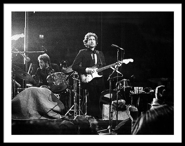 Bob Dylan plays guitar on stage, with Levon Helm Framed Print
