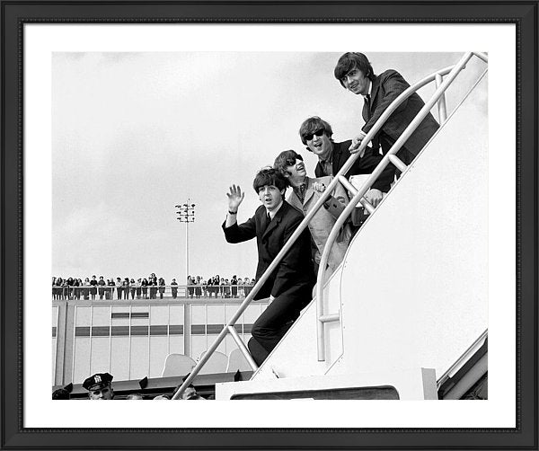 Beatles fly home to England after their second American tour of the year.