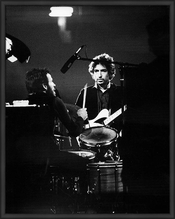 Levon Helm (1940 - 2012), on drums, and Bob Dylan, on guitar