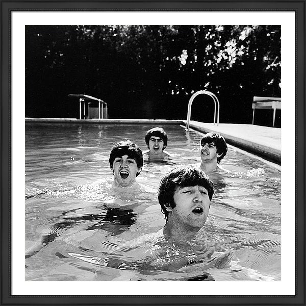 The Beatles taking a dip in a swimming pool