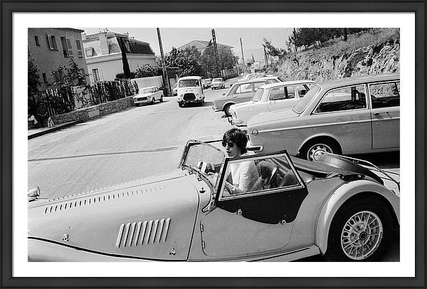 Mick Jagger at the wheel of his Morgan Plus 8 roadster