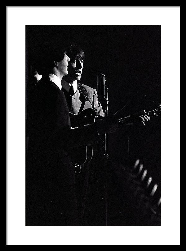 Paul McCartney and George Harrison of The Beatles pop group