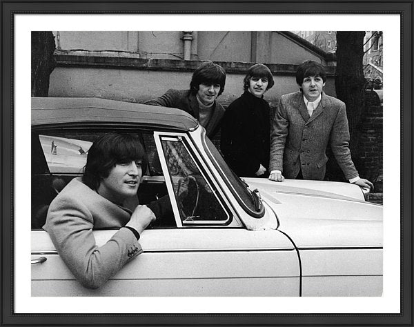 The Beatles, sits in car after passing driving test, February 16, 1965