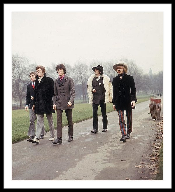 The Rolling Stones take a stroll in a London park