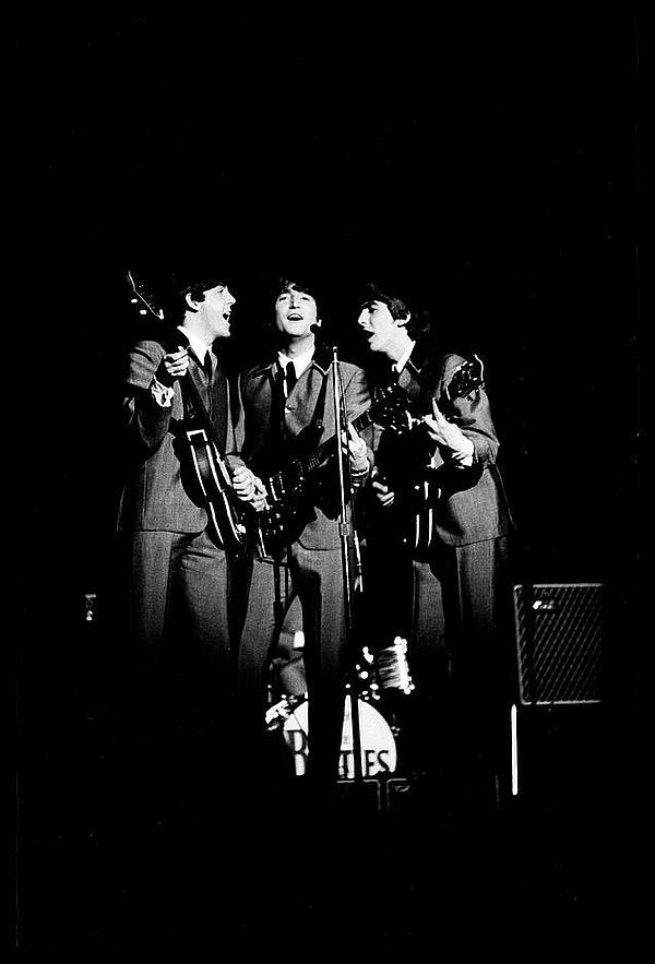 British pop group the Beatles perform on stage, 1964.