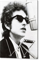 Bob Dylan sings into old fashion microphone
