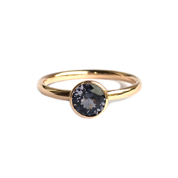14k rosé gold ring set with an iolite