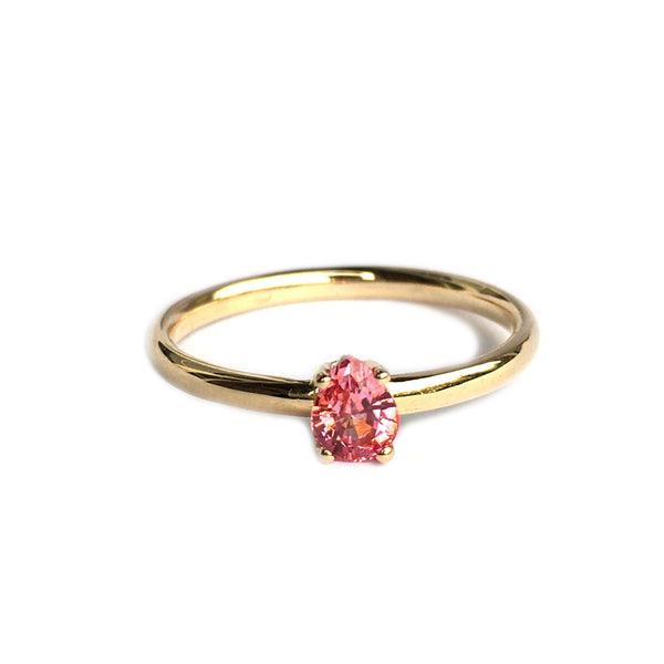 14k yellow gold ring with a pink sapphire