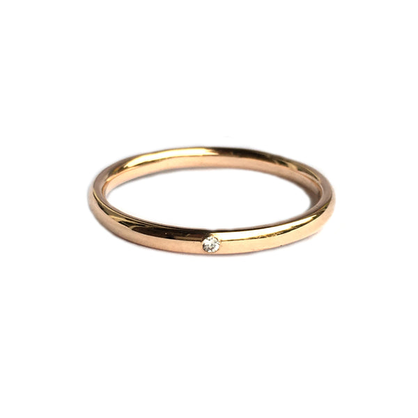 14k rosé gold ring set with a diamond