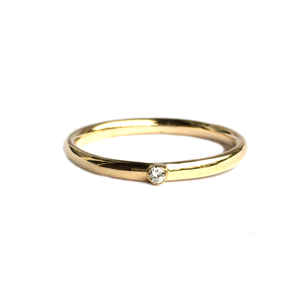 14k yellow gold ring set with a brilliant shaped diamond