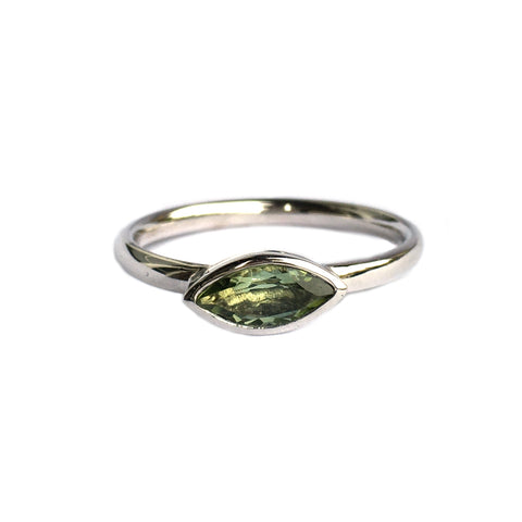 14k white gold ring set with an olive green tourmaline