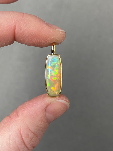 Ethiopian Opal pendant in yellow gold