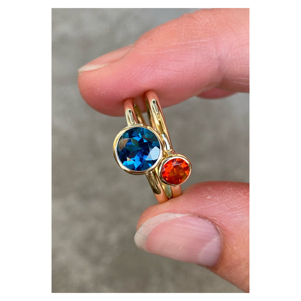 14k yellow gold ring set with a fire opal