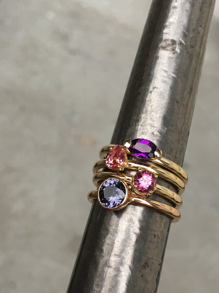 14k yellow gold ring set with a garnet
