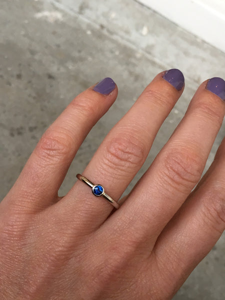 14k white gold ring with a blue Sapphire