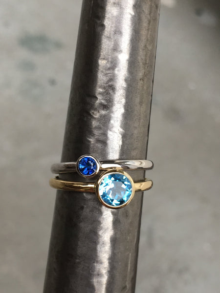 14k yellow gold ring set with a Swiss blue topaz