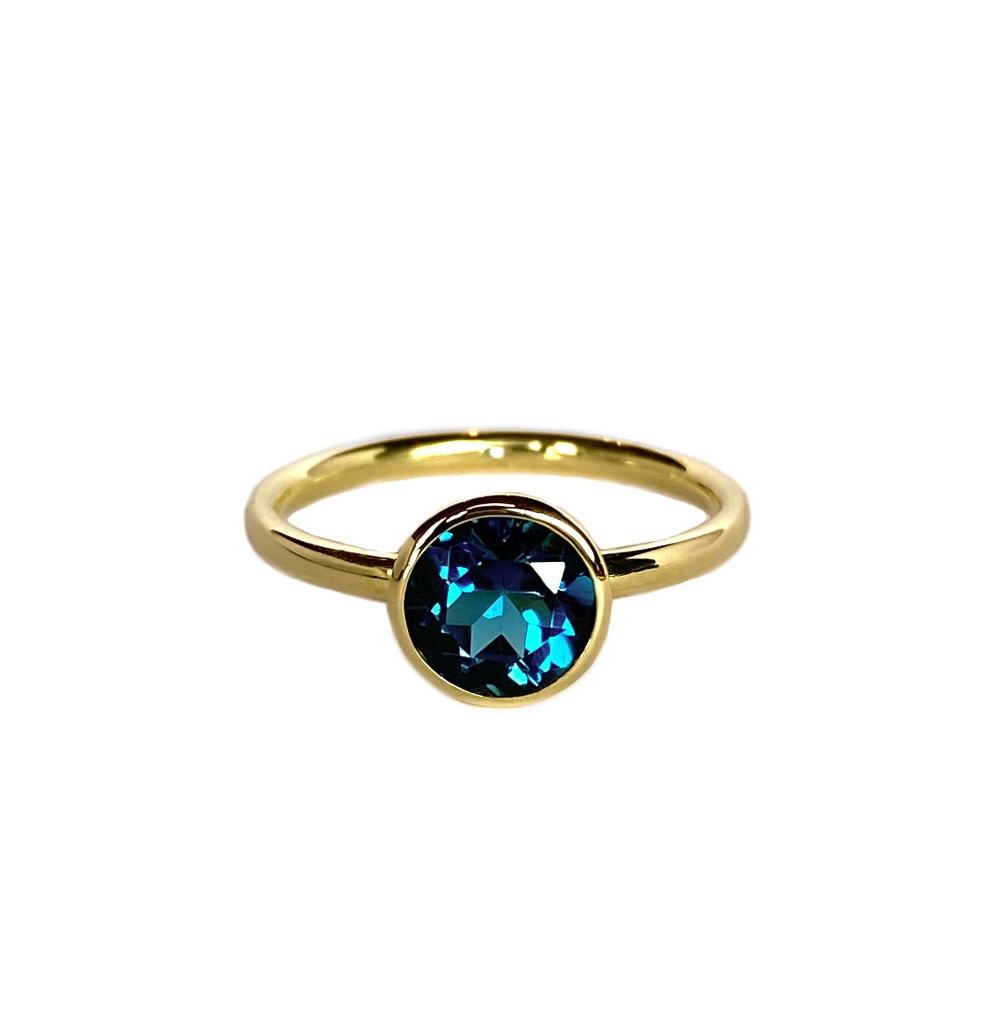 14k yellow gold ring set with a london blue topaz