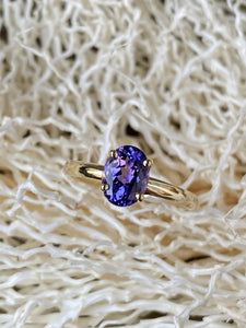 14k yellow gold ring set with an oval Tanzanite