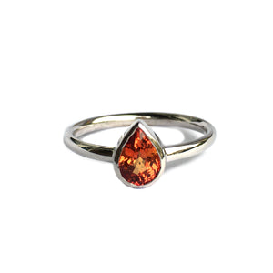 14k white gold ring with orange sapphire
