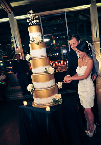 Erika, KeepCake Co-Founder, cuts her wedding cake with her boss
