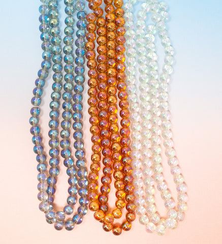 Glass AB Lustre bead strands in blue, peach and clear - 8mm
