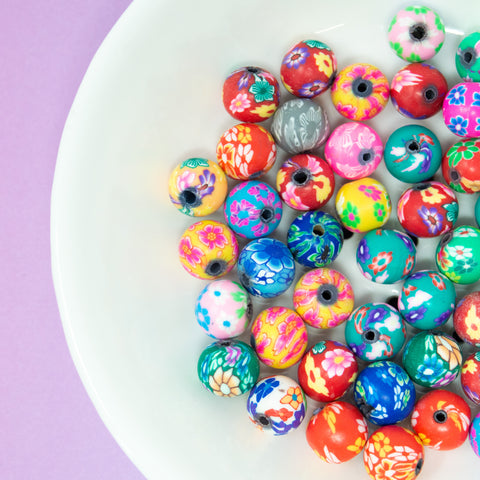 Assorted Flow Clay Polymer Beads, ideal for Spring beading activities. Come in a variety of colours and floral patterns - round in shape.