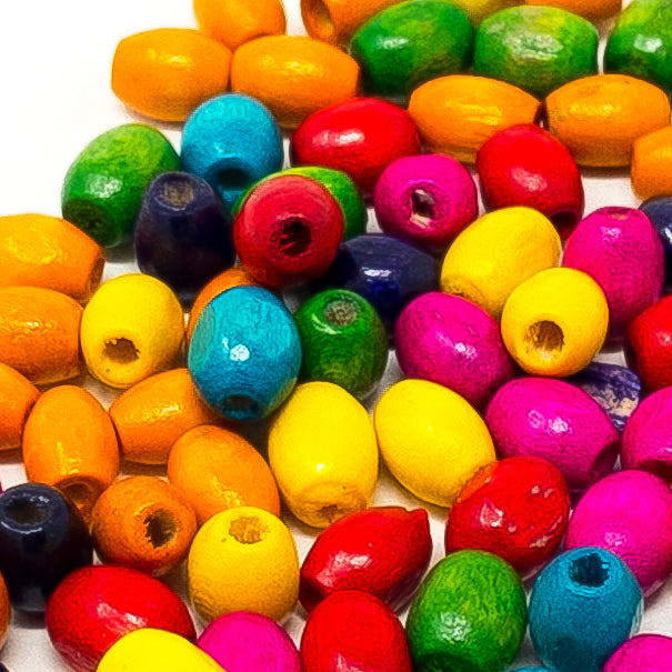 Bright Coloured Wooden Rice Beads. 4mmx6mm. 50g/Approx 1100. 1.5mm Hole.