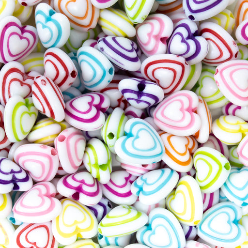 White acrylic heart beads with brightly coloured outlining. 5mm size in packs of 100. Available from Big Little Store, Cornwall.