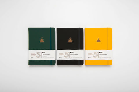 Power of 3 undated goal planners in forest green, charcoal and sunshine yellow