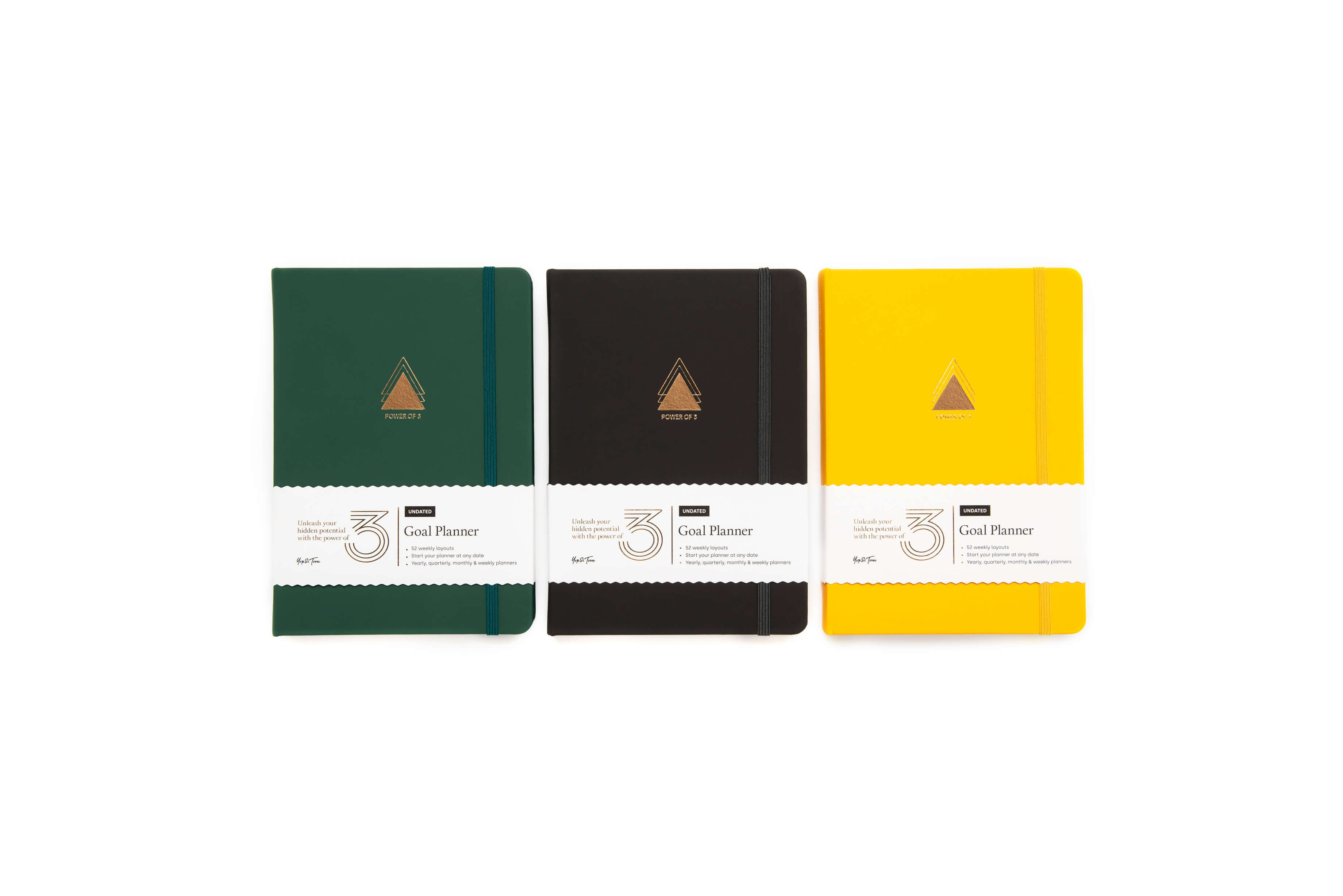 Power of 3 goal planners in forest green, charcoal and sunshine yellow