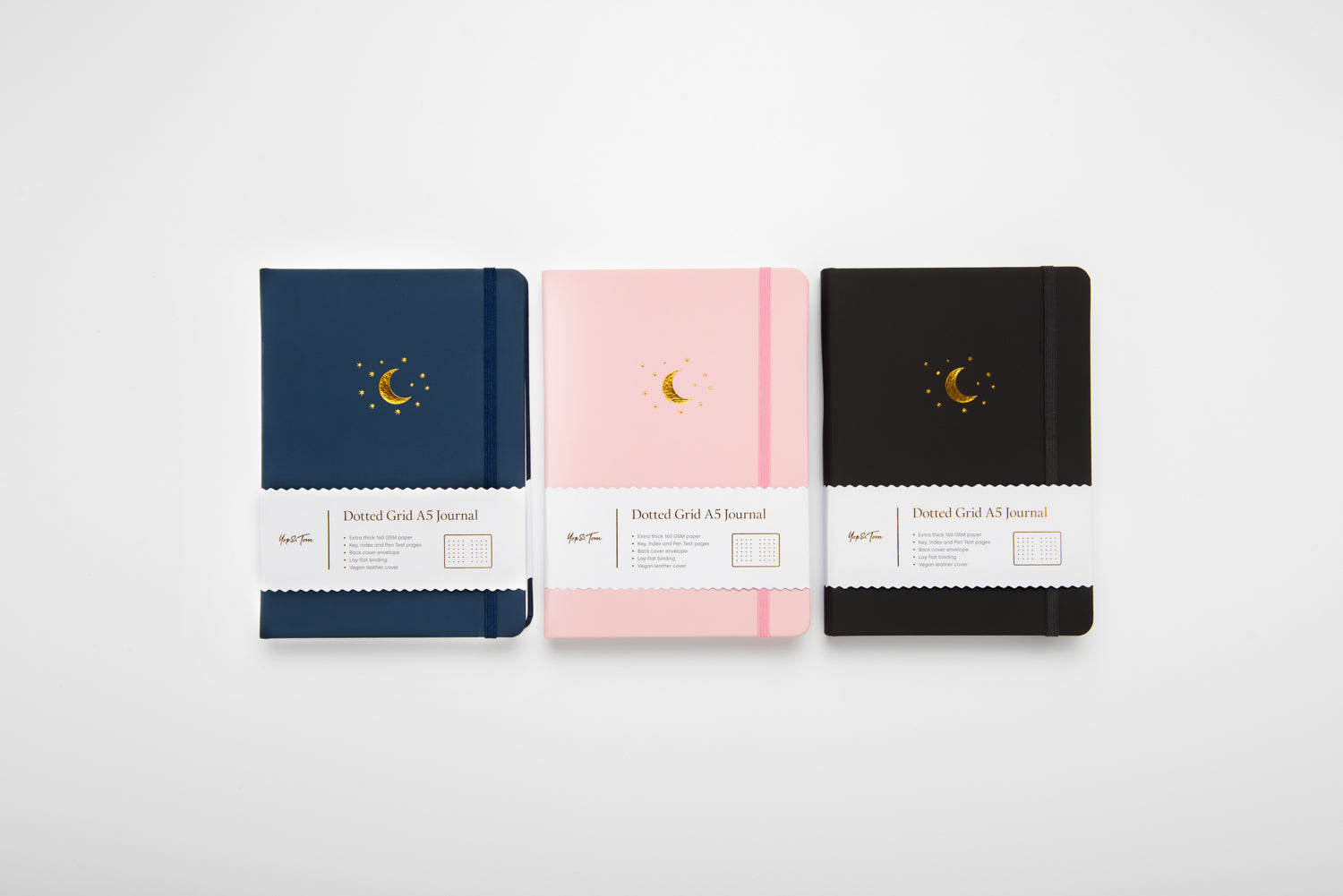 3 moon and star journals in blue pink and charcoal