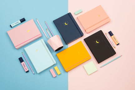 Yop & Tom notebooks on a pink and blue background