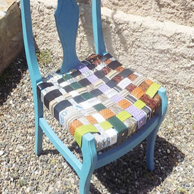 Chair with seat woven from upcycled belts