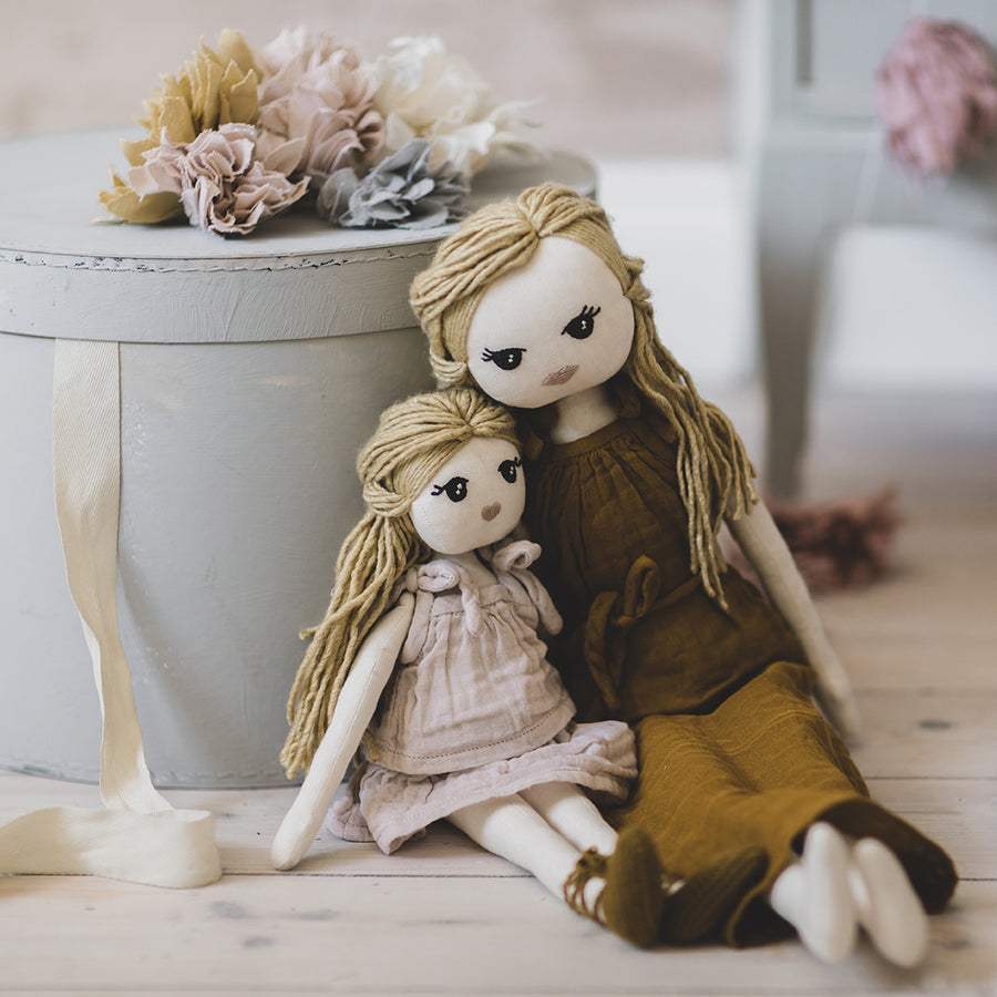 Poeme lifestyle sells beautiful soft and handcrafted organic cotton mum doll online in Australia. For endless dolls play.