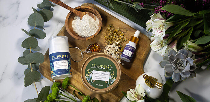 Deerieo skincare products moisturiser, face mask and oil serum on a wooden board
