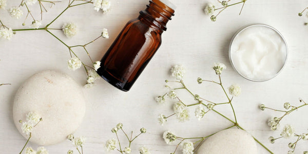 natural skincare ingredients in a dropper bottle and cream