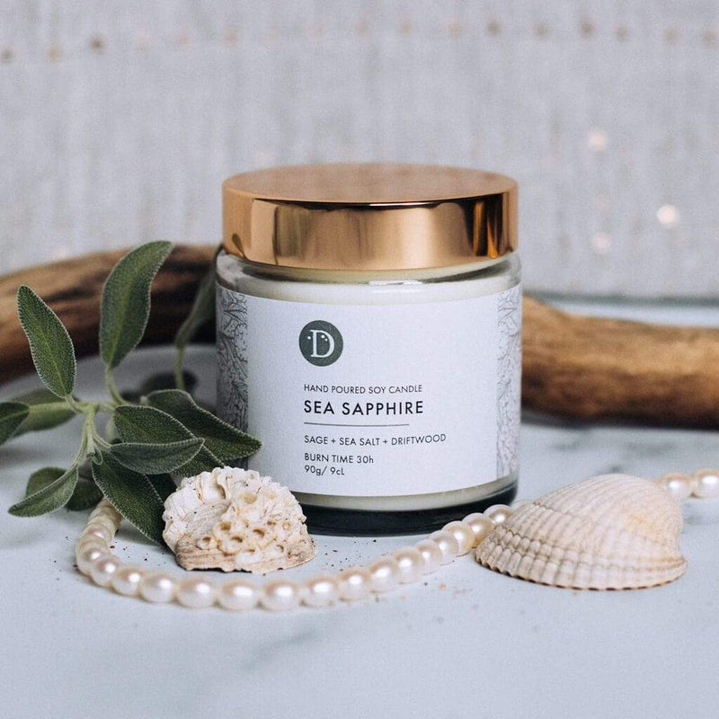 Deerieo Sea Sapphire votive soy candle limited edition scented with sage, sea salt, driftwood.