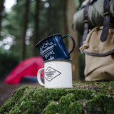 "Blue enamel mug with white text ""The Adventure Begins"""