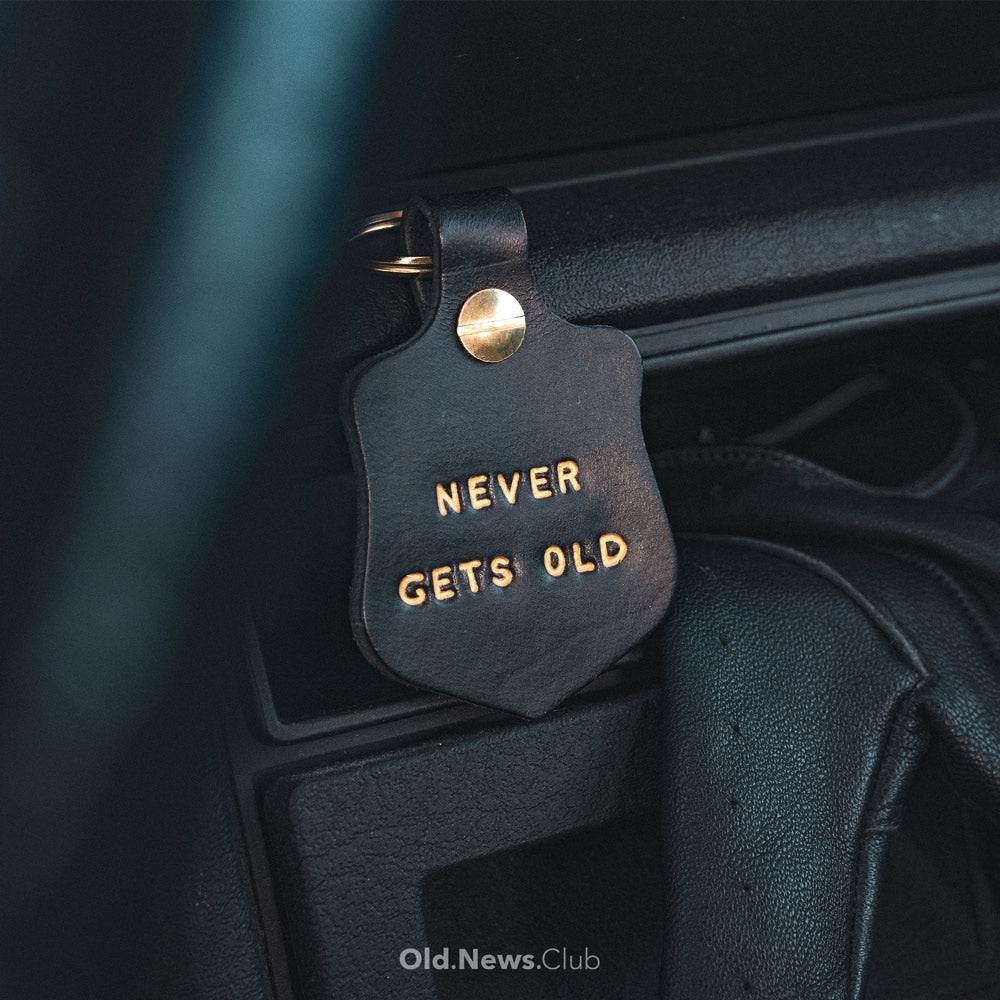 Leather Key Fob with gold embossed text in classic car