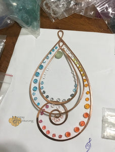 Paisley-esque Suncatcher made with gemstones and Swarovski Crystal is wire art waiting to be hung in your home