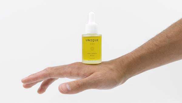 unique CBD bottle on back of hand