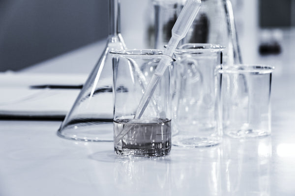science lab glassware on table