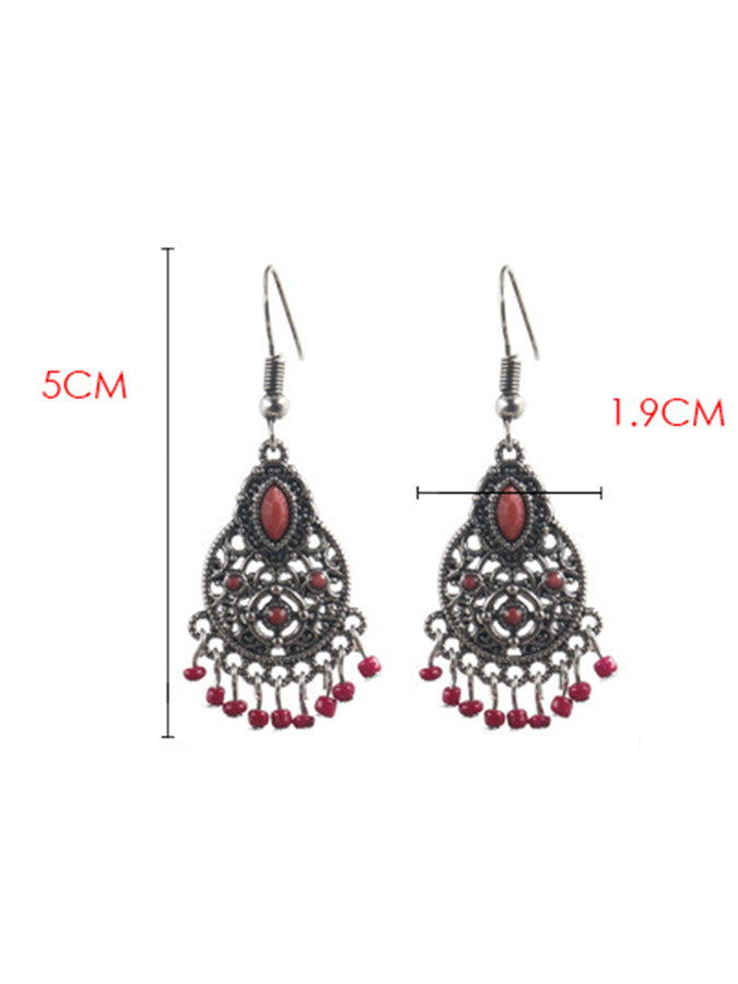 Tassel earrings in exaggerated braided rice beads